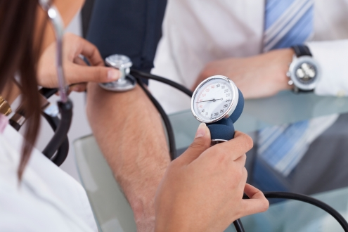 Doctor Checking Blood Pressure Of Businessman
