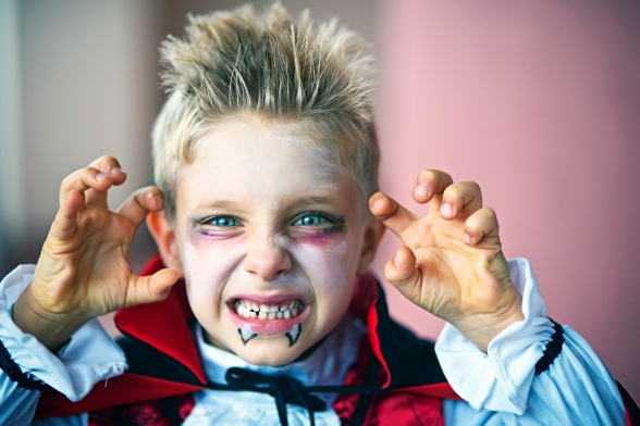 Portrait of a little boy dressed up as halloween vampire