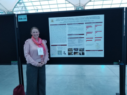 Audrey presents her poster at the EB poster session.