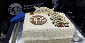 Birthday cake celebrating milestone anniversaries for APS journals.